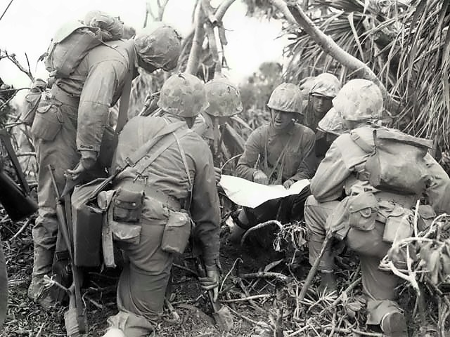 A company of American Marines are briefed during the Battle of Iwo Jima, 20 February 1945