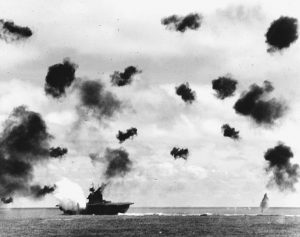 USS Yorktown is hit by a Japanese aerial torpedo during the Battle of Midway