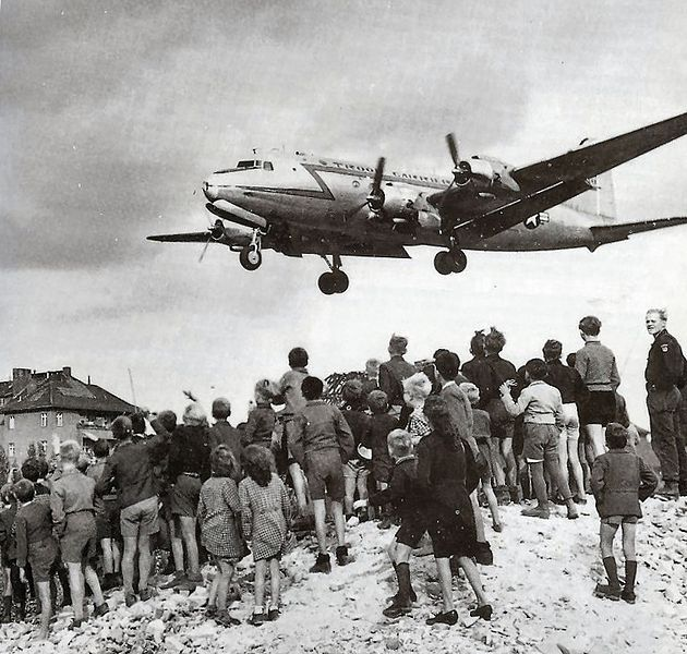 Berliners watching a C-54 land during Berlin Airlift, 1948