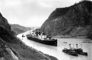 A ship sails through the Panama Canal in 1915