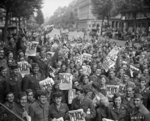 American servicemen and women in Paris celebrate V-J Day, August 15, 1945